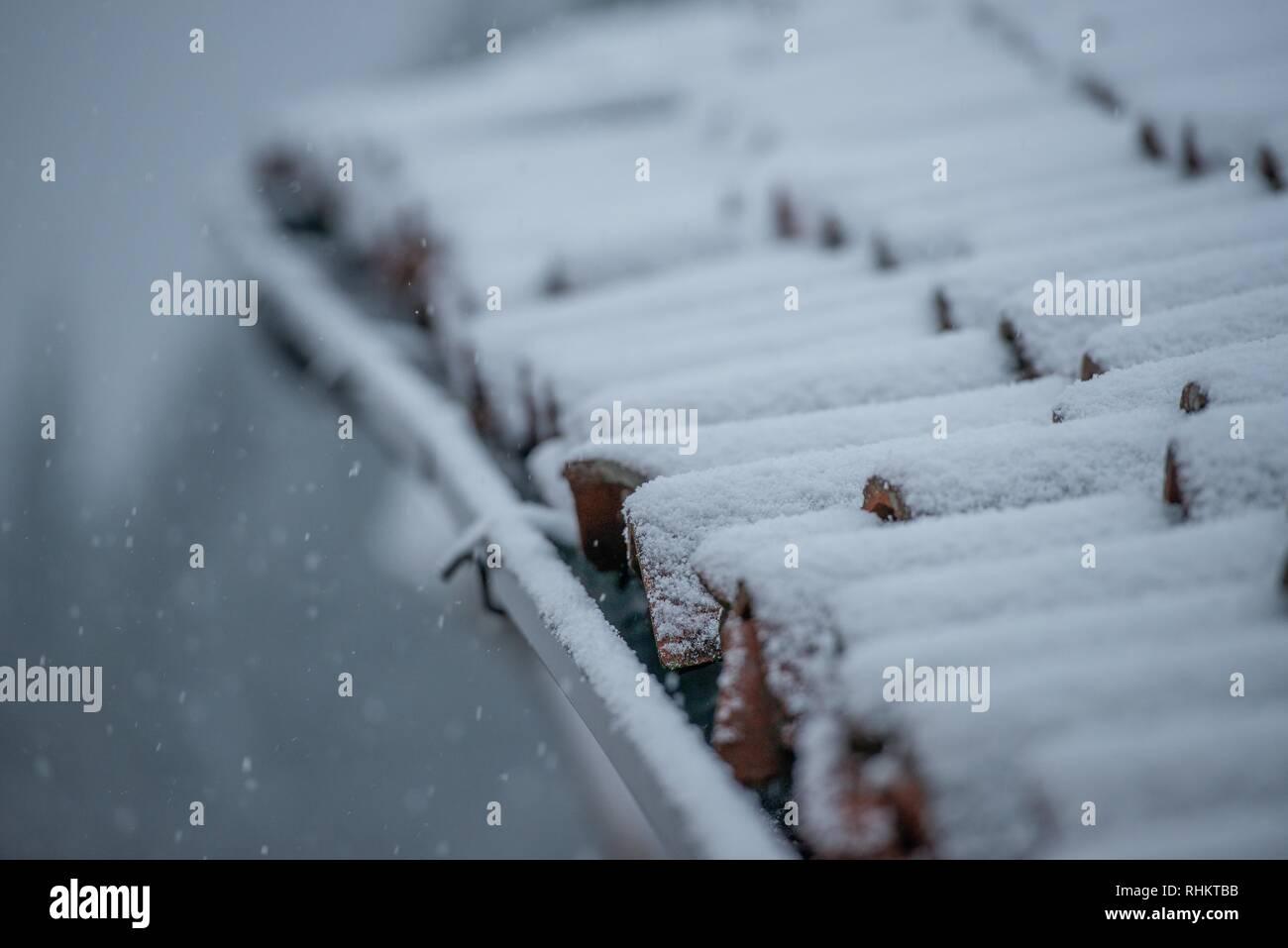 roof during an abundant snowfall - Stock Image
