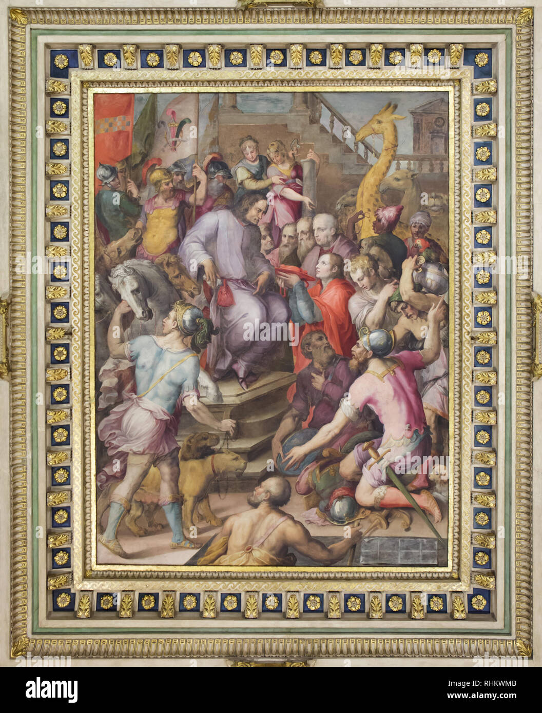Ambassadors of the most powerful foreign states paying tribute to Lorenzo the Magnificent. Ceiling painting by Italian Mannerist painters Giorgio Vasari and Marco Marchetti da Faenza (1556-1558) in the Room of Lorenzo the Magnificent (Sala di Lorenzo il Magnifico) in the Apartments of Pope Leo X (Quartiere di Leone X) in the Palazzo Vecchio in Florence, Tuscany, Italy. The gift laid before Lorenzo the Magnificent include the cardinal's hat which the pope granted to his son Giovanni, the future pope Leo X. Stock Photo