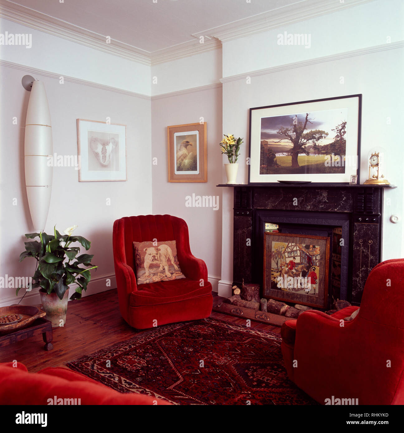 Red Velvet Chairs Beside Marble Fireplace In Living Room Stock Photo Alamy