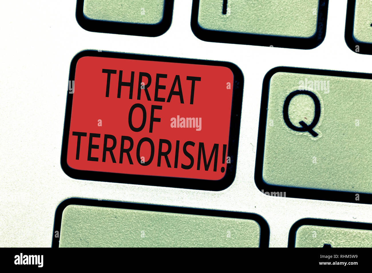 Handwriting text writing Threat Of Terrorism. Concept meaning unlawful use violence and intimidation against civilians Keyboard key Intention to creat - Stock Image