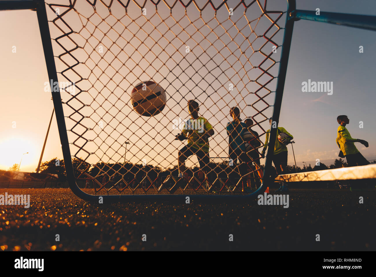 Boys Football Goalkeepers Improving Skills on Soccer Training. Kids Soccer Goalkeeper Training Session. Youth Soccer Goalies Practicing Catching Ball - Stock Image