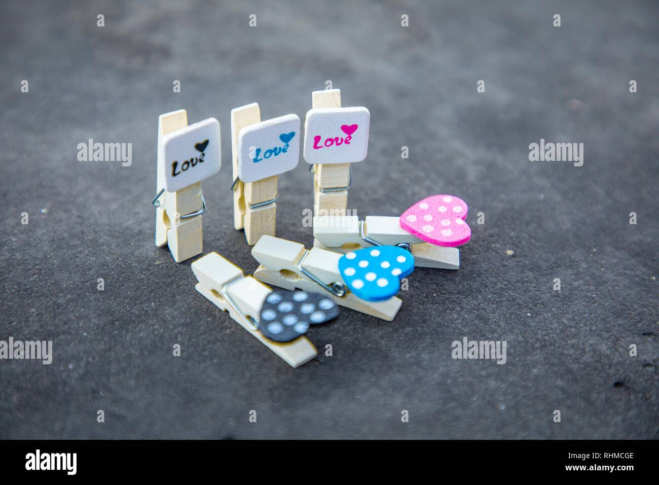 Artistic cute lovely pegs alignment background with hearts and polka dots -  Valentine's Day - Stock Image