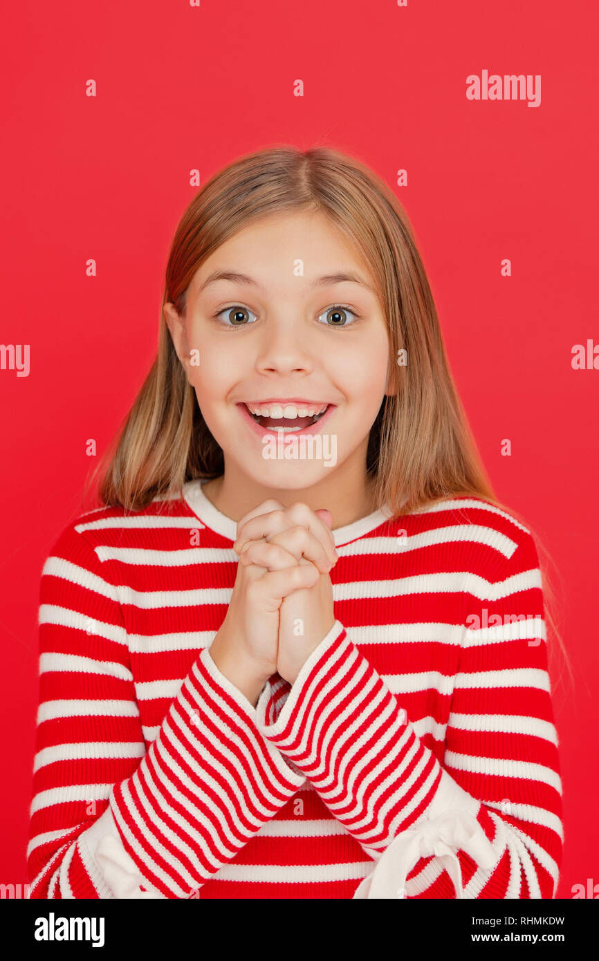 Child girl dreaming her wish come true. Miracle happens. Little girl smiling full of hope. My secret wish. Make a wish. Hope for the best. Girl hopeful excited face making wish. Believe in miracle. - Stock Image