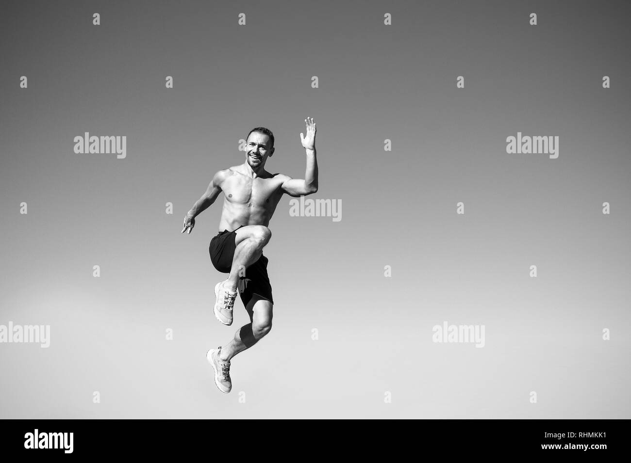 Its the health activities my body really responds to. Man jump high in air. Muscular man celebrate success in sport. Master of sport. Muscular energy. Health care. Think big goals and win big success. - Stock Image