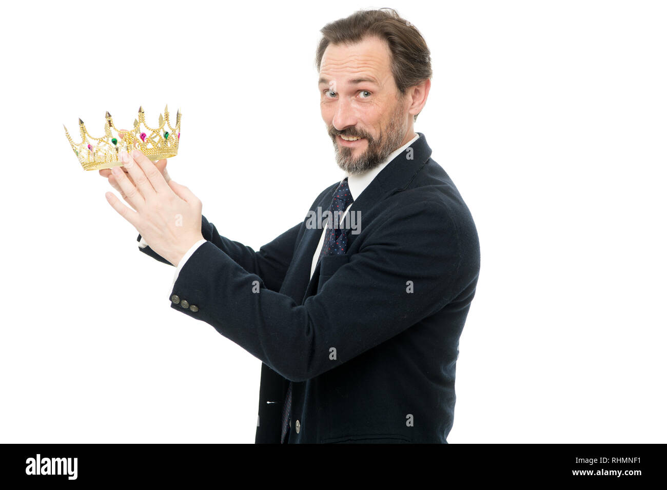 Become next king. Monarchy family traditions. King attribute. Man nature bearded guy in suit hold golden crown symbol of monarchy. Direct line to throne. Enormous privilege. Become king ceremony. - Stock Image