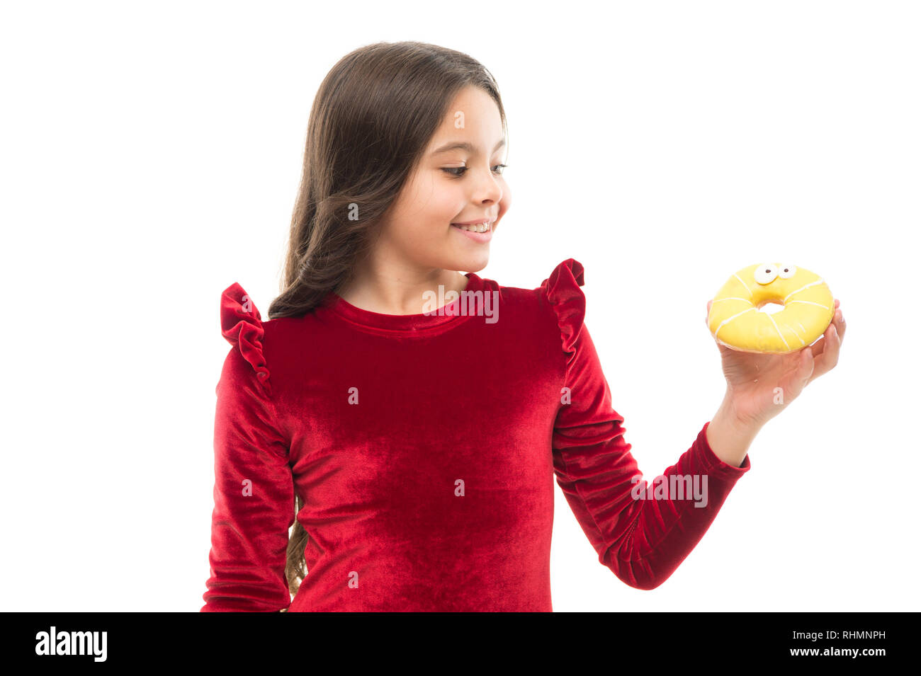 Sweet obsession. Happy childhood and sweet treats. Breaking diet concept. Girl hold sweet donut white background. Child hungry for sweet donut. Sugar levels and healthy nutrition. Nutritionist advice. - Stock Image