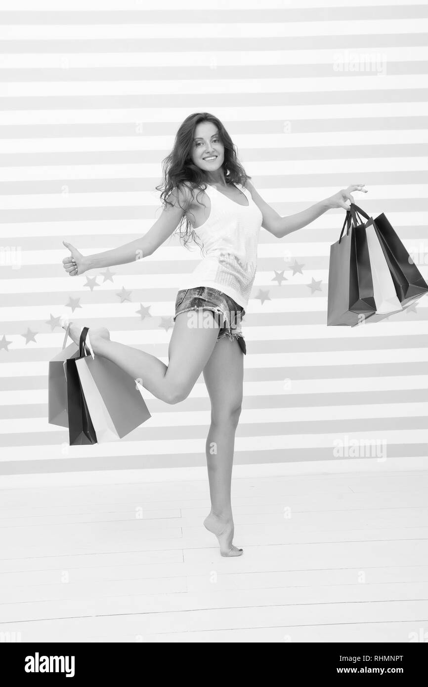she made a right choice. shopping girl with happy face and thumb up. great sale. time for shopping. happy girl with paperbags on colorful background. carefree and excited buyer showing thumb up Stock Photo