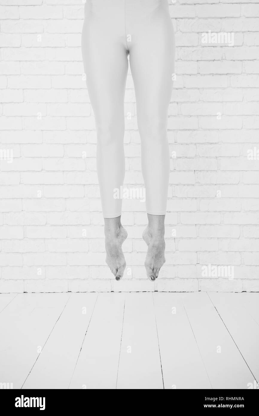 Feet jump. Her ambition knows no bounds. Ballet dancers feet. High jump. Her great ambition is to be a dancer. - Stock Image