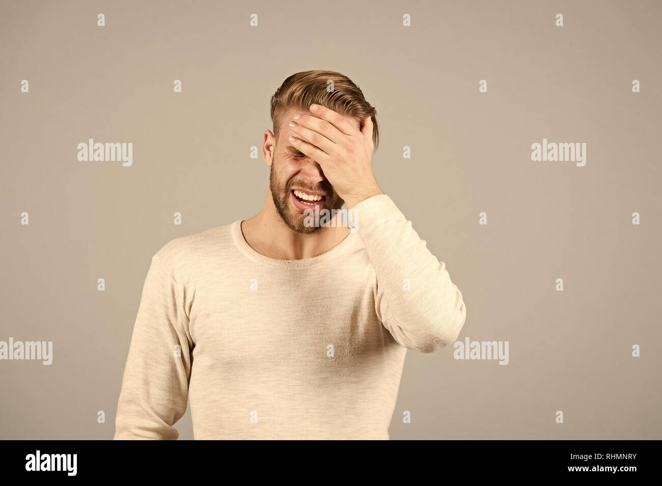 Bad memory concept. Man bearded forgetful face, grey background. Man with beard unshaven guy looks forgetfully and disapponted. Guy bearded attractive with hairstyle forgetful expression, copy space. - Stock Image
