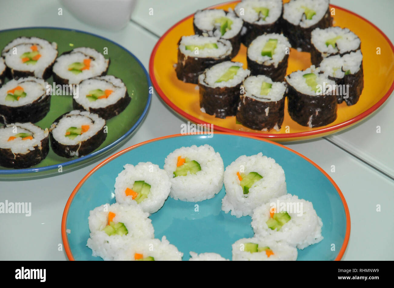 Platters of vegetarian sushi vegetables and rice wrapped in seaweed - Stock Image