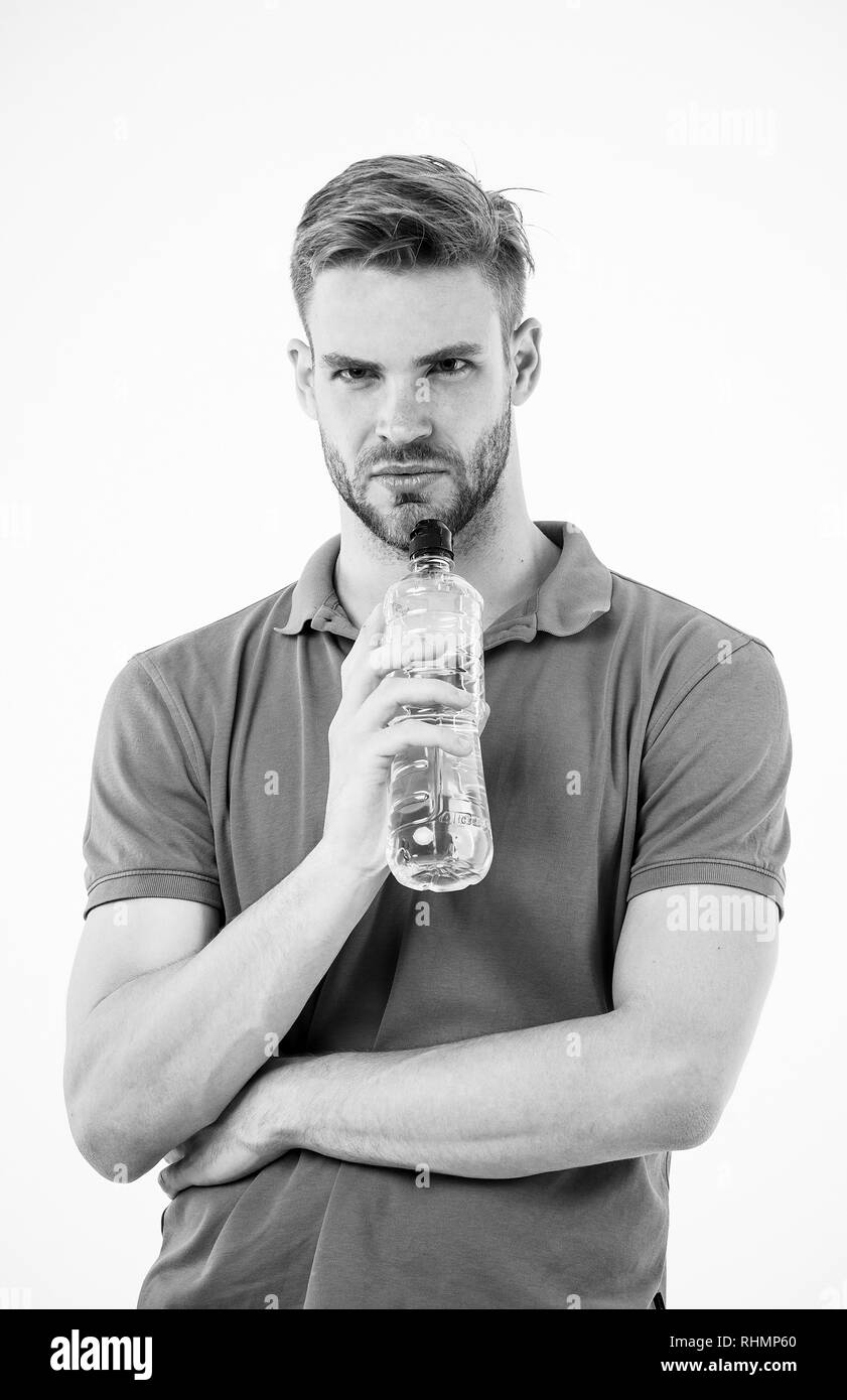 Sip of freshness after great workout. Man athlete hold water bottle. Athlete drink water after training. Man athlete hold bottle. Sportsman care hydration body. Athlete healthy lifestyle concept. - Stock Image