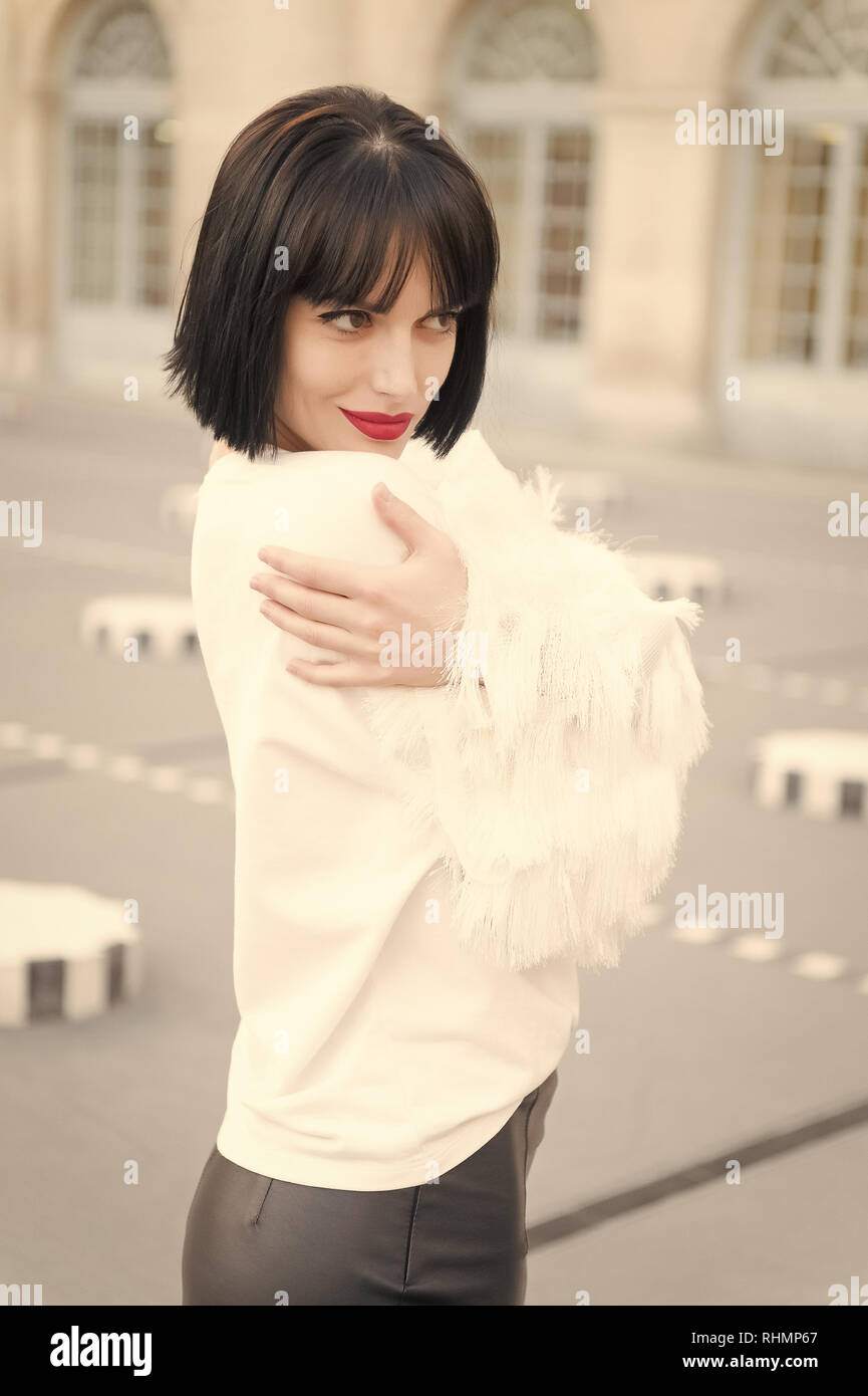 Portrait of happy young woman smiling in paris, france. - Stock Image