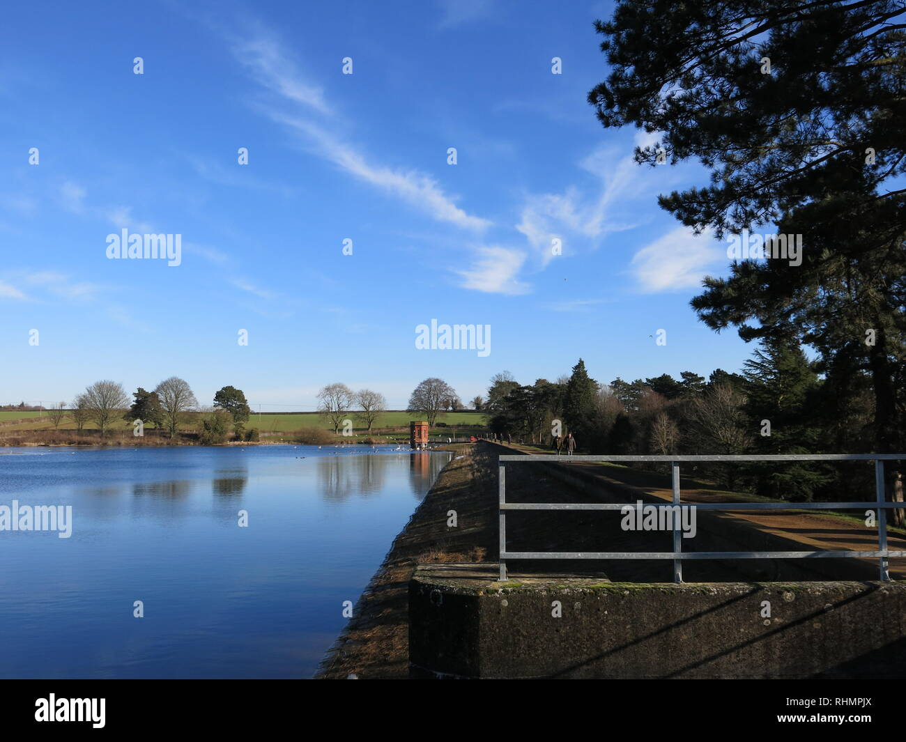 A winter scene of the reservoir on a sunny day at Sywell Country Park, Northamptonshire, February 2019 - Stock Image