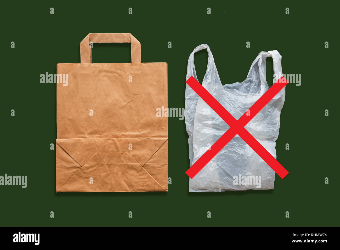 Paper and plastic bag on a dark background. Say No to plastic bags. The concept of choice without plastic or environmental problems. - Stock Image