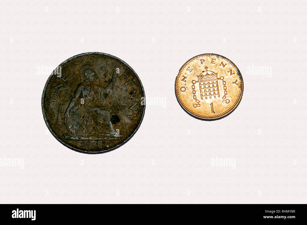 Example of pre and post decimal British 1 penny coinage showing different size and design - Stock Image