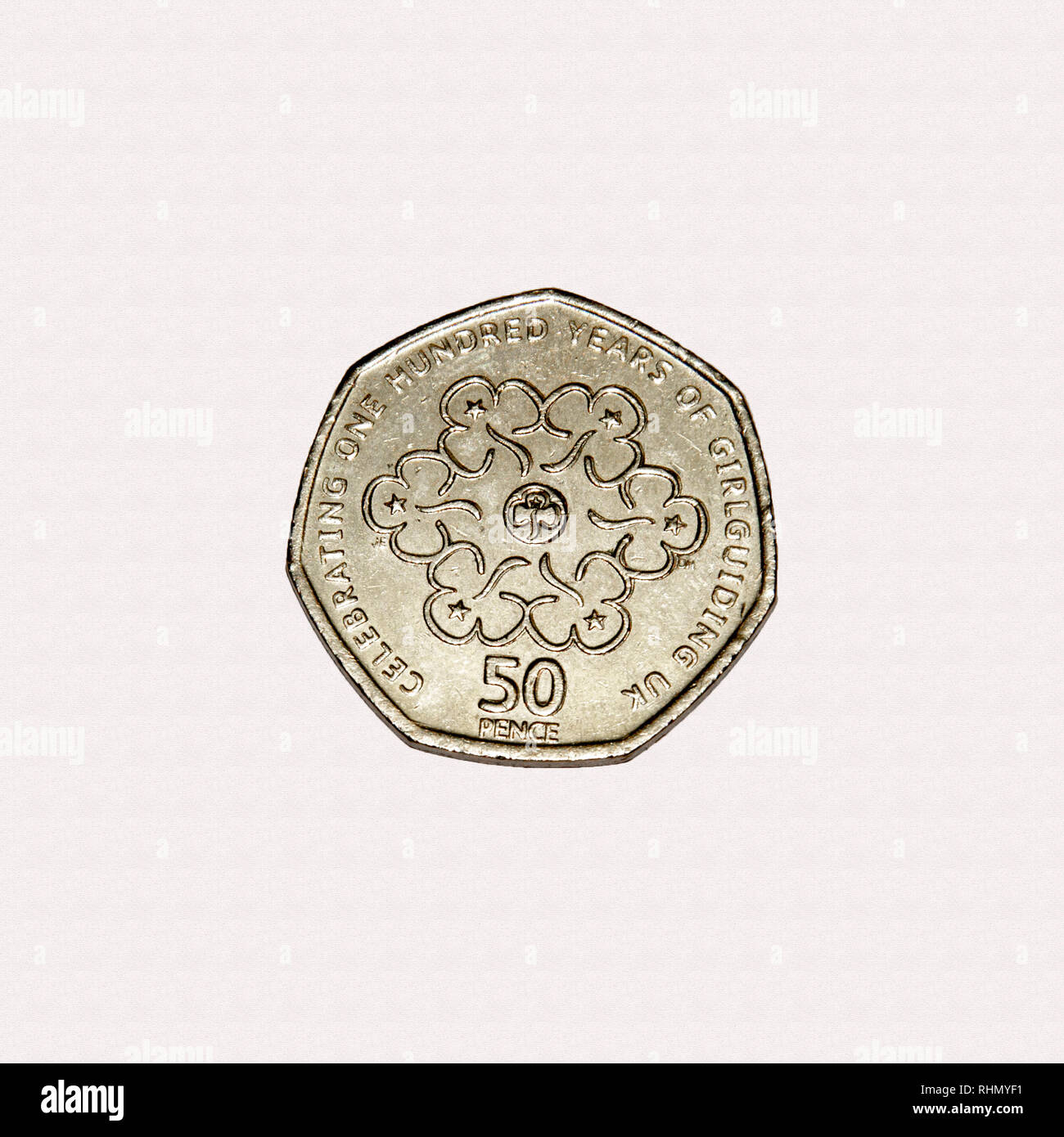 Limited edition British 50p piece coin commemorating one hundred years of the Girl Guides movement Stock Photo