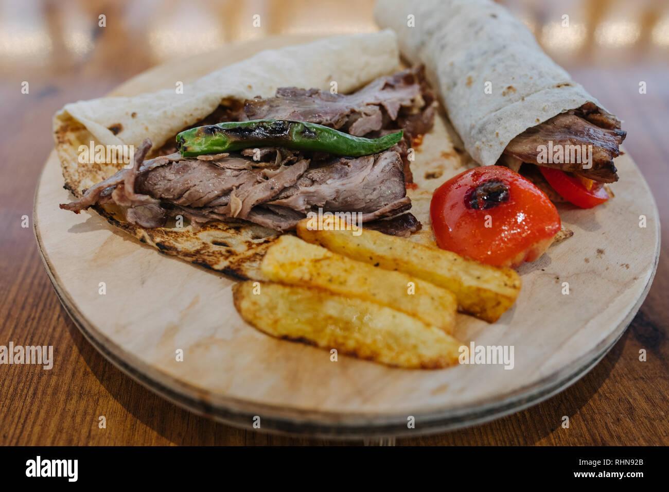 Turkish Doner Kebab Wrap Shawarma Or Gyros Traditional Turkish Doner Kebab Meat Sandwich Wrap Shawarma Or Gyros In Restaurant Stock Photo Alamy