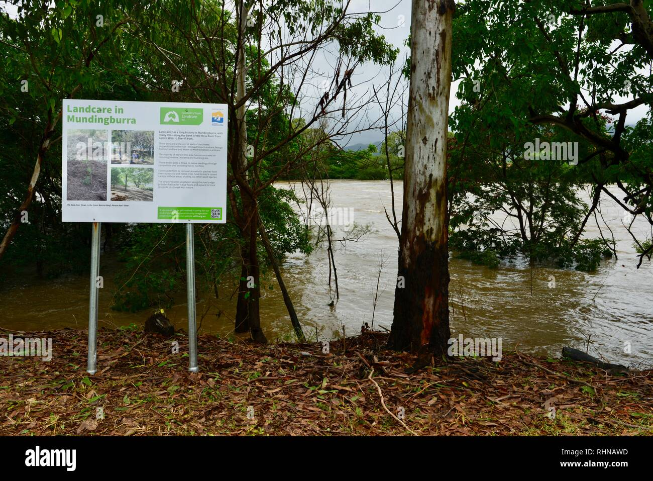 Landcare in Mundingburra sign, Queensland, Australia. 3 February 2019. Flooding continued to worsen as the deluge continued and more water was released from the bulging Ross River dam to prevent the failure of the dam wall. Credit: P&F Photography/Alamy Live News Stock Photo