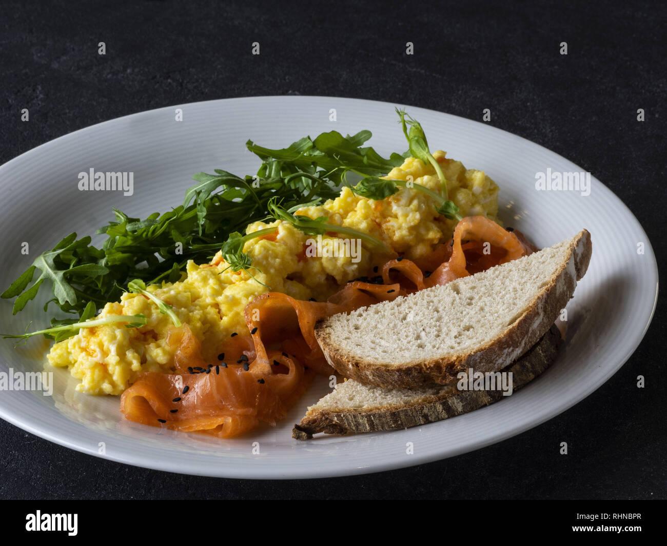 Kiev, Ukraine. 28th Jan, 2019. Scramble with salmon and arugula seen served on a plate. Credit: Igor Golovniov/SOPA Images/ZUMA Wire/Alamy Live News - Stock Image