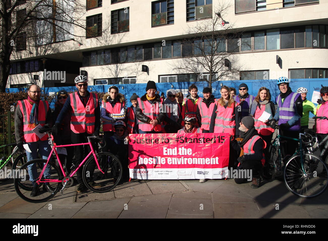 London, UK, February 3rd 2019. Cyclists gather in central London to take part in a ten mile ride in support of the 'Stansted 15'. Before setting off some of the cyclists gather with a banner reading: 'Justice to the Stansted 15. End the Hostile Environment'. The 'Stanstead 15' are a group of protesters who surrounded an aircraft at Stansted airport in 2017 to prevent it being used to carry out a deportation. The 15 have been found guilty of terrorism related charges and will be sentenced in Chelmsford on February the 6th. Roland Ravenhill/Alamy Live News - Stock Image