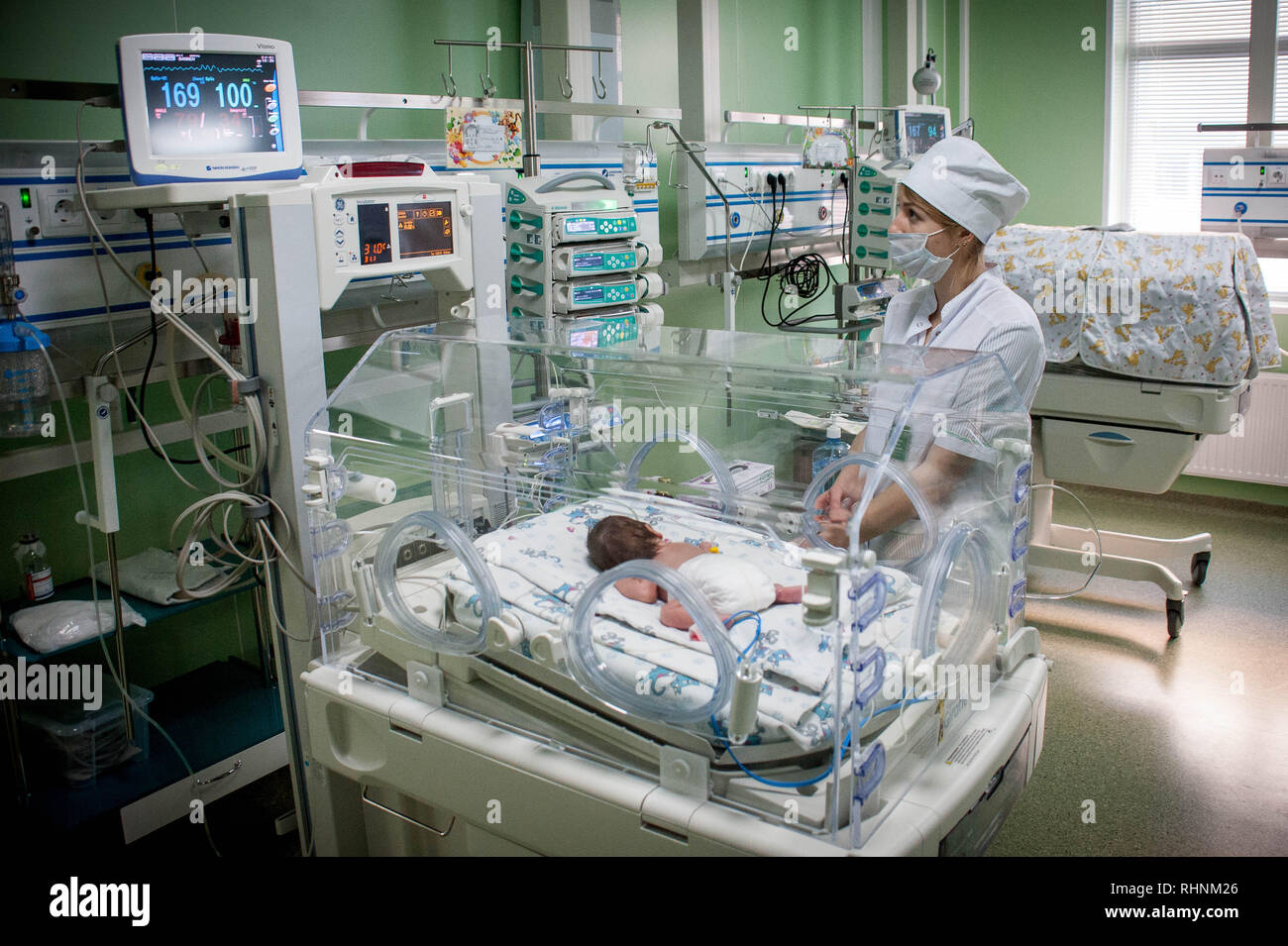 Low Birth Weight Babies Stock Photos & Low Birth Weight