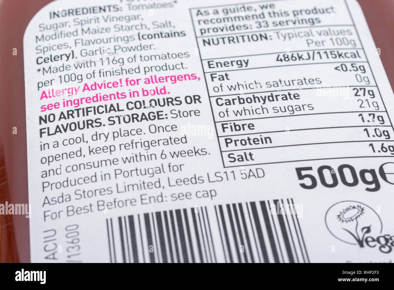 ASDA tomato sauce label stating no use of artificial colours or flavours. - Stock Image