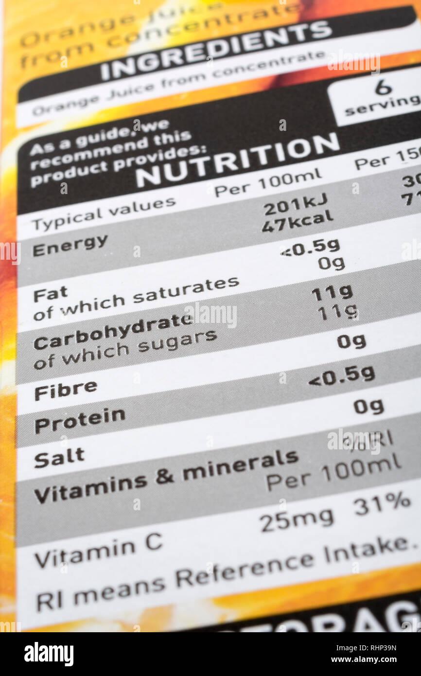 ASDA orange juice nutrition label - showing sugar / carbohydrate content. - Stock Image