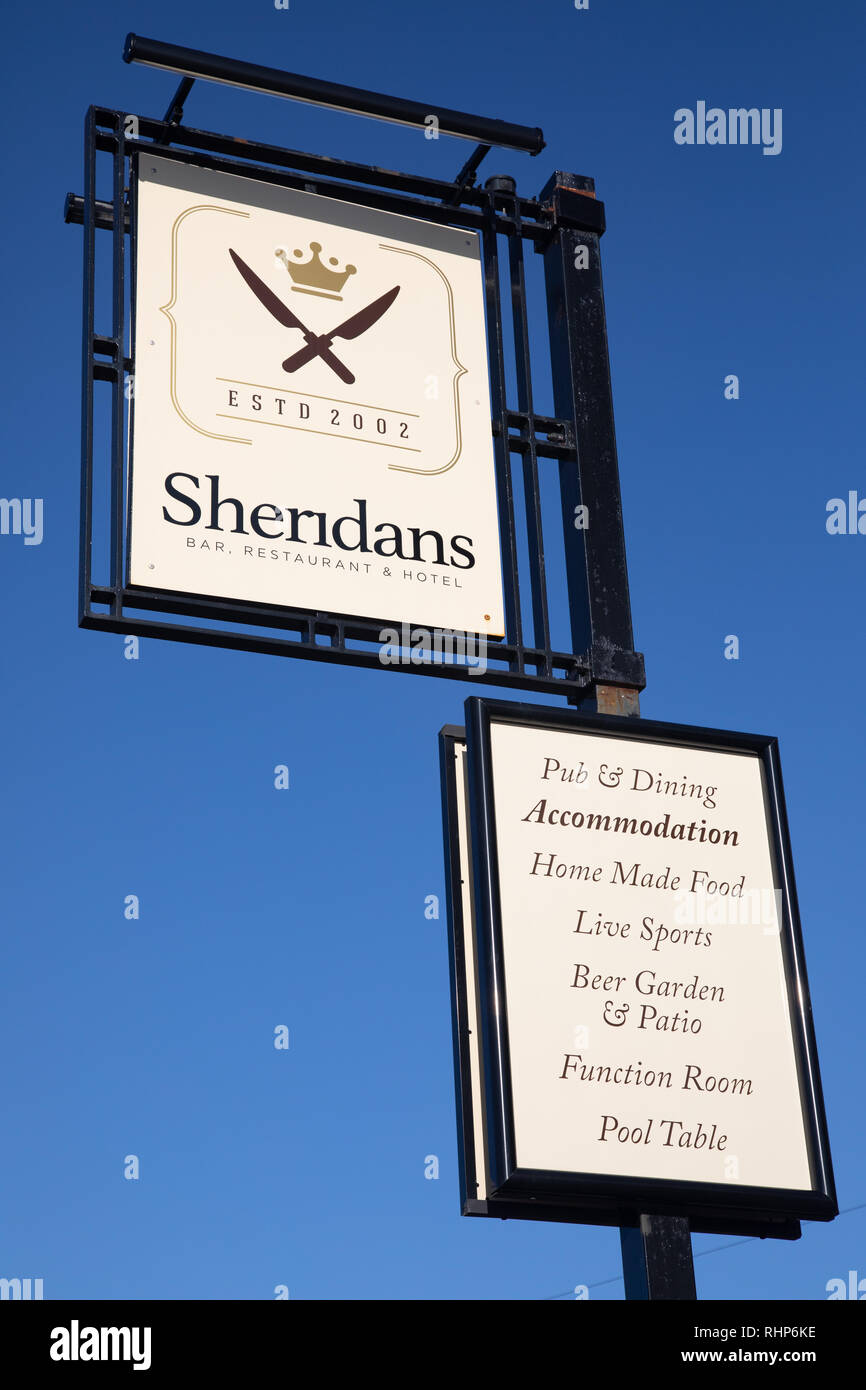 Exterior sign for Sheridans bar restaurant and hotel indicating services provided Wallasey Village February 2019 Stock Photo