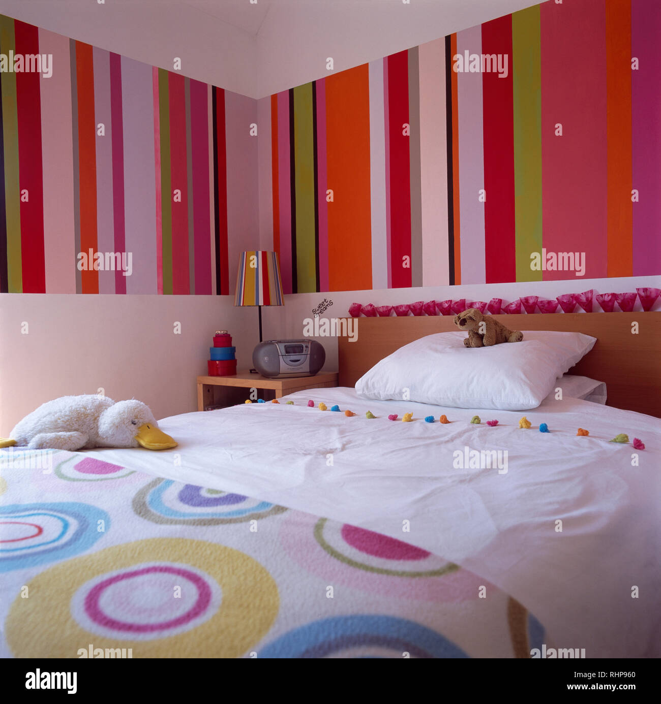 Colourful Striped Wallpaper In Modern Bedroom