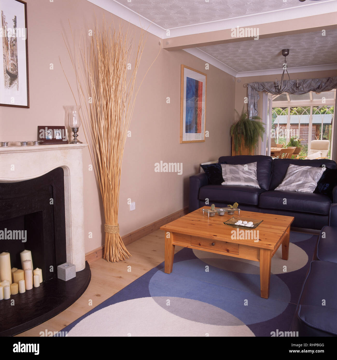 Pine coffee table and leather sofa in economy living room Stock ...