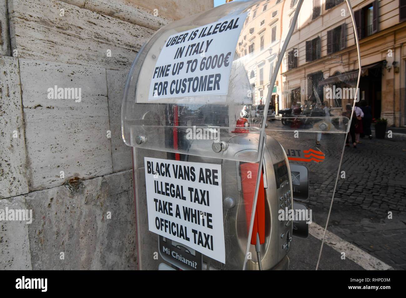 Rome, Italy - September 30 2018: A sign near a taxi station prohibiting the use of uber in the historic center of Rome, Italy. Stock Photo
