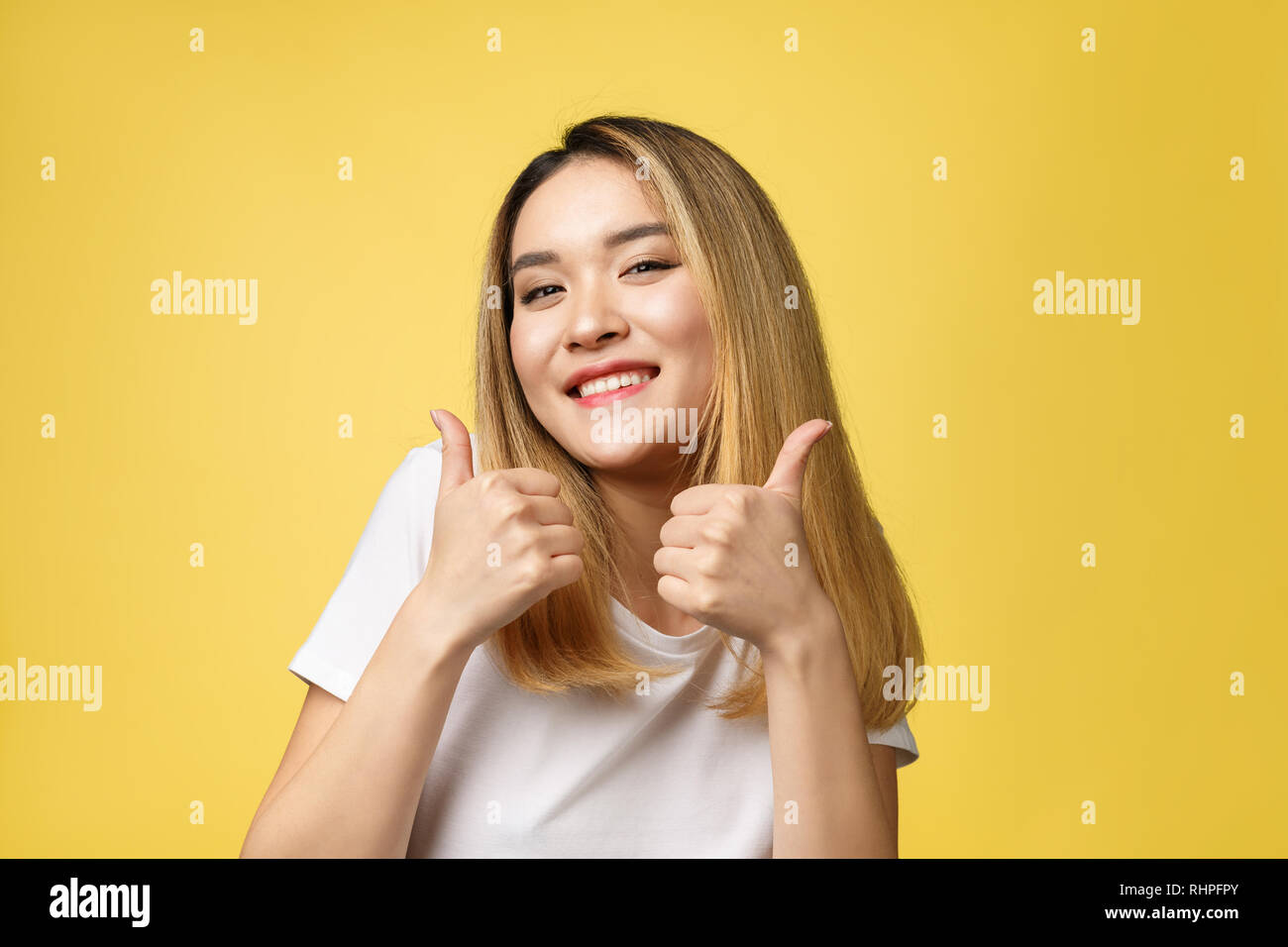 0f9bf62a32871 Young Asian Woman Showing Thumbs Stock Photos   Young Asian Woman ...