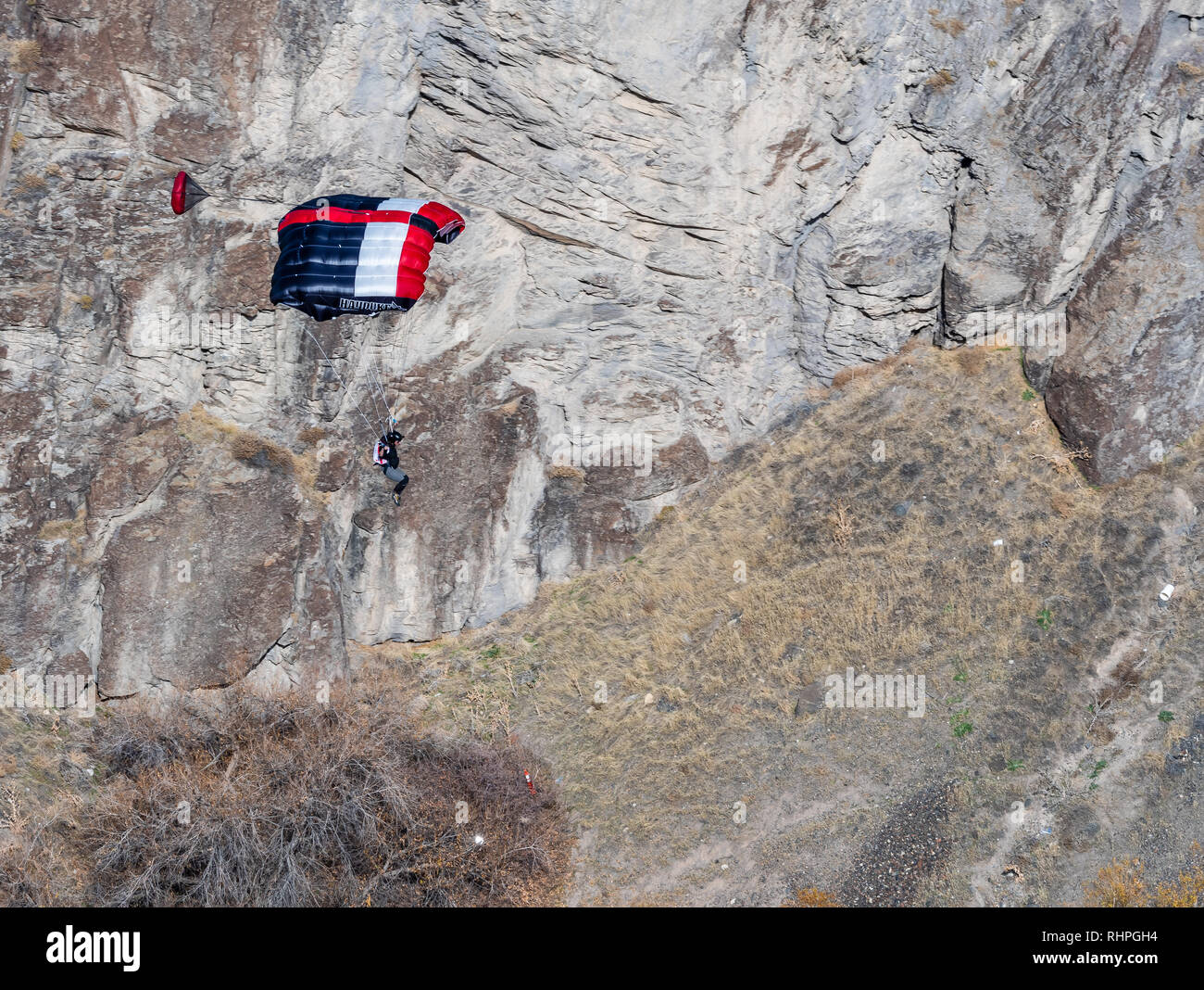 Base jumper leaps of the Perrine Bridge In Twin Falls Idaho - Stock Image