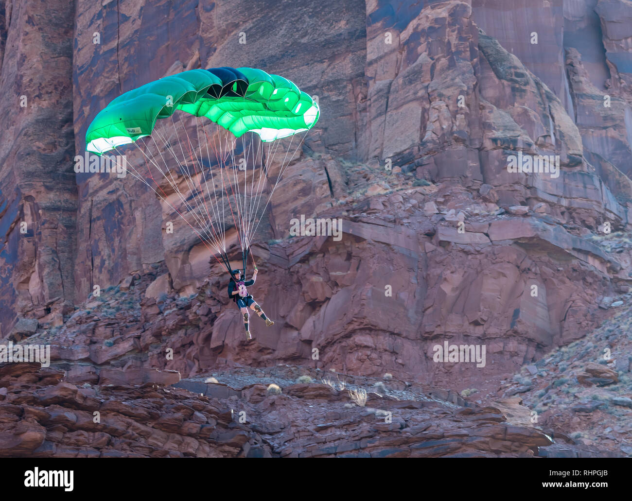 Rowan Lovell BASE jumping near Moab Utah - Stock Image