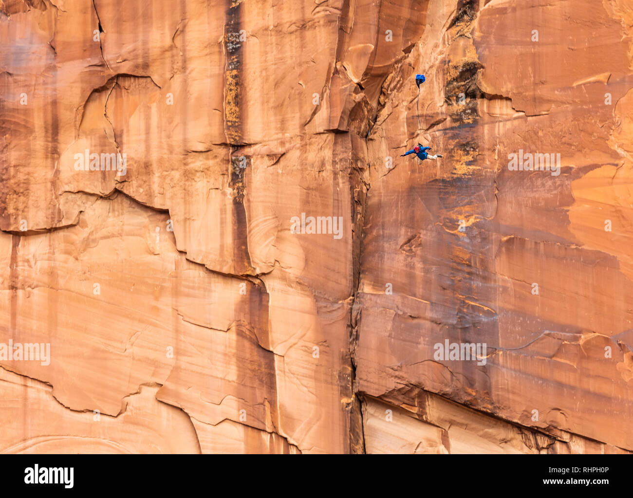 Rollin Gieker BASE jumps from an exit point called Tombstone near Moab Utah - Stock Image