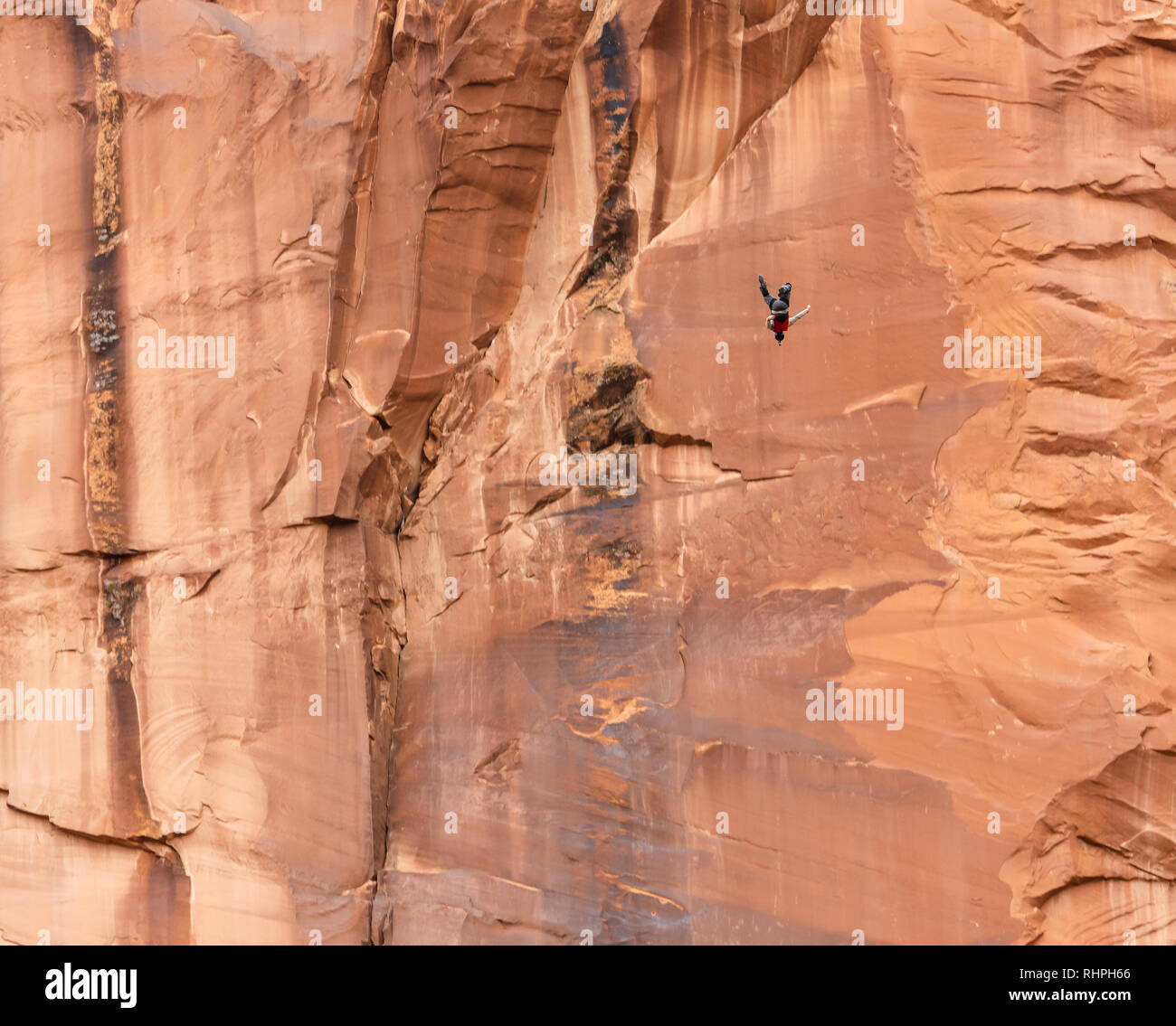 Aaron Stuyvenberg jumps from an exit point called Tombstone near Moab Utah - Stock Image