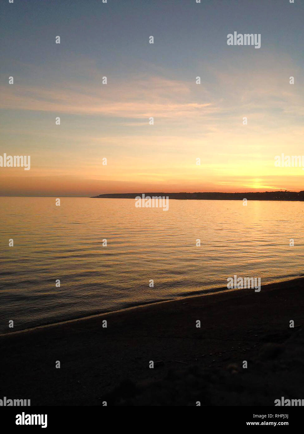 sunset by the sea mobile photography - Stock Image