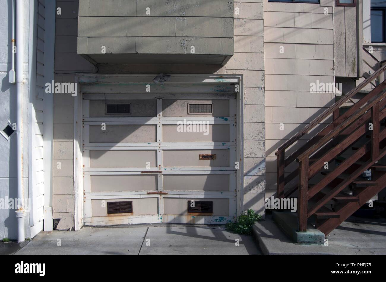 Garage doors can take on many different shapes, sizes and designs. - Stock Image