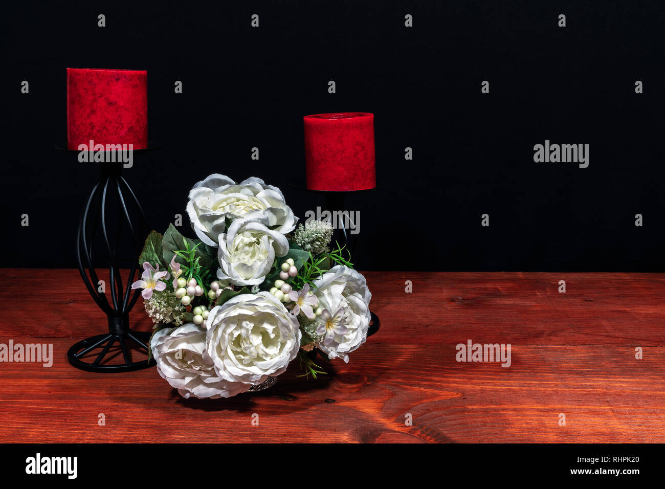 Beautiful bouquet of arranged flowers red candles on a holder on a wooden table. mothers day, Easter, valentines, birthday, Christmas, Stock Photo
