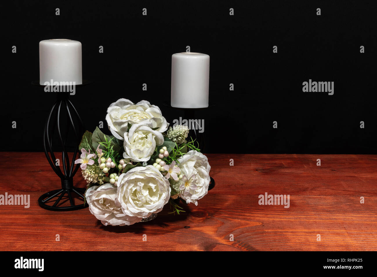 Beautiful bouquet of arranged flowers white candles on a holder on a wooden table. mothers day, Easter, valentines, birthday, Christmas, Stock Photo