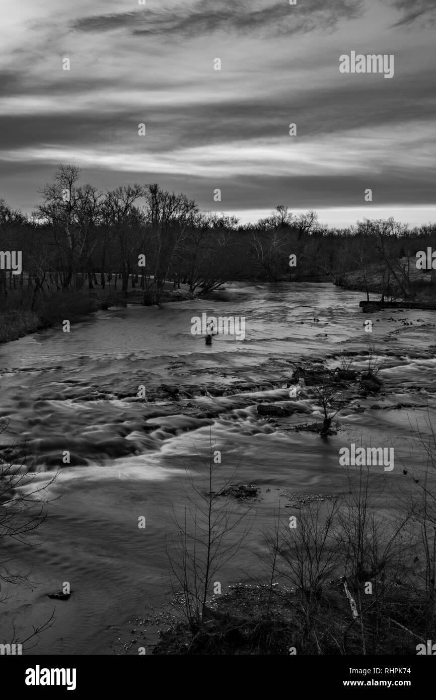 Sunrise over Shoal Creek in Joplin, Missouri - Stock Image