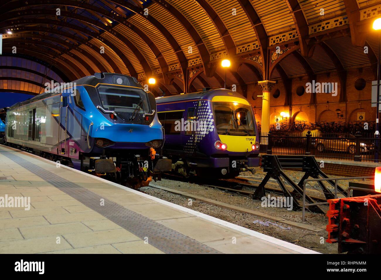 Transpennine Express 68027 & Scot Rail 170454 parked side by side at York Station - Stock Image