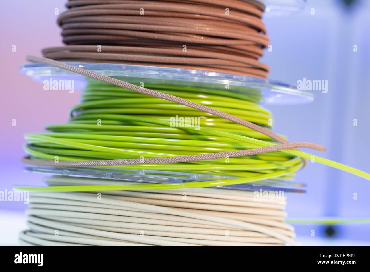 Spools of plastic PETG filaments for 3D Printer - Stock Image
