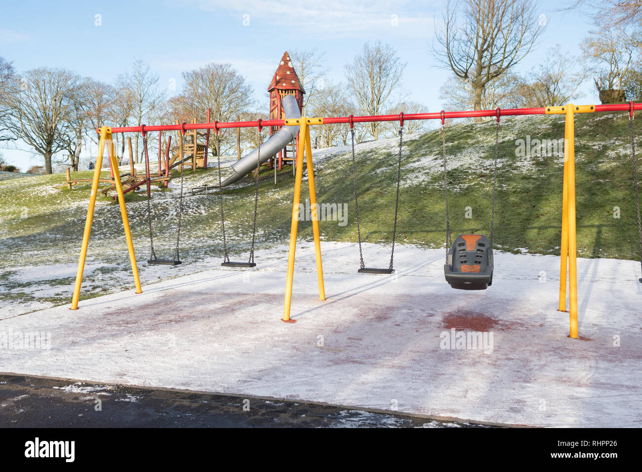 disabled access swing seat in children's play park area in Duthie Park, Aberdeen, Scotland, UK - Stock Image