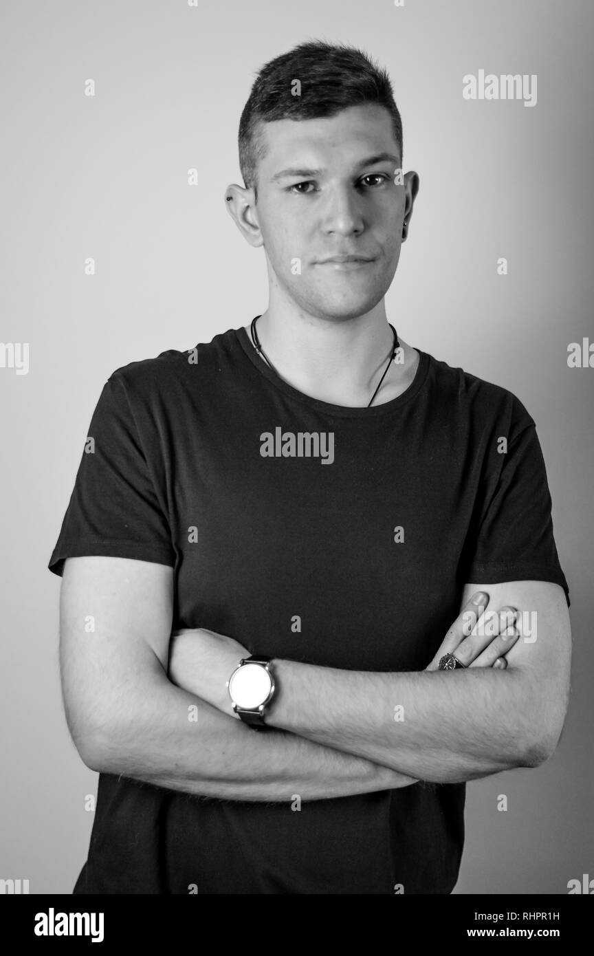 Portrait of confident young man in black t shirt stock image