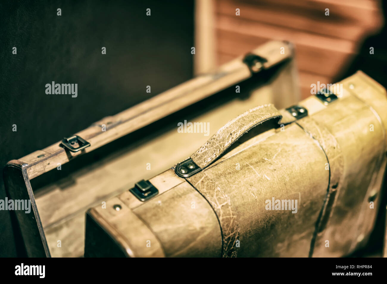 Old wooden travel suitcase closeup. Vintage background - Stock Image