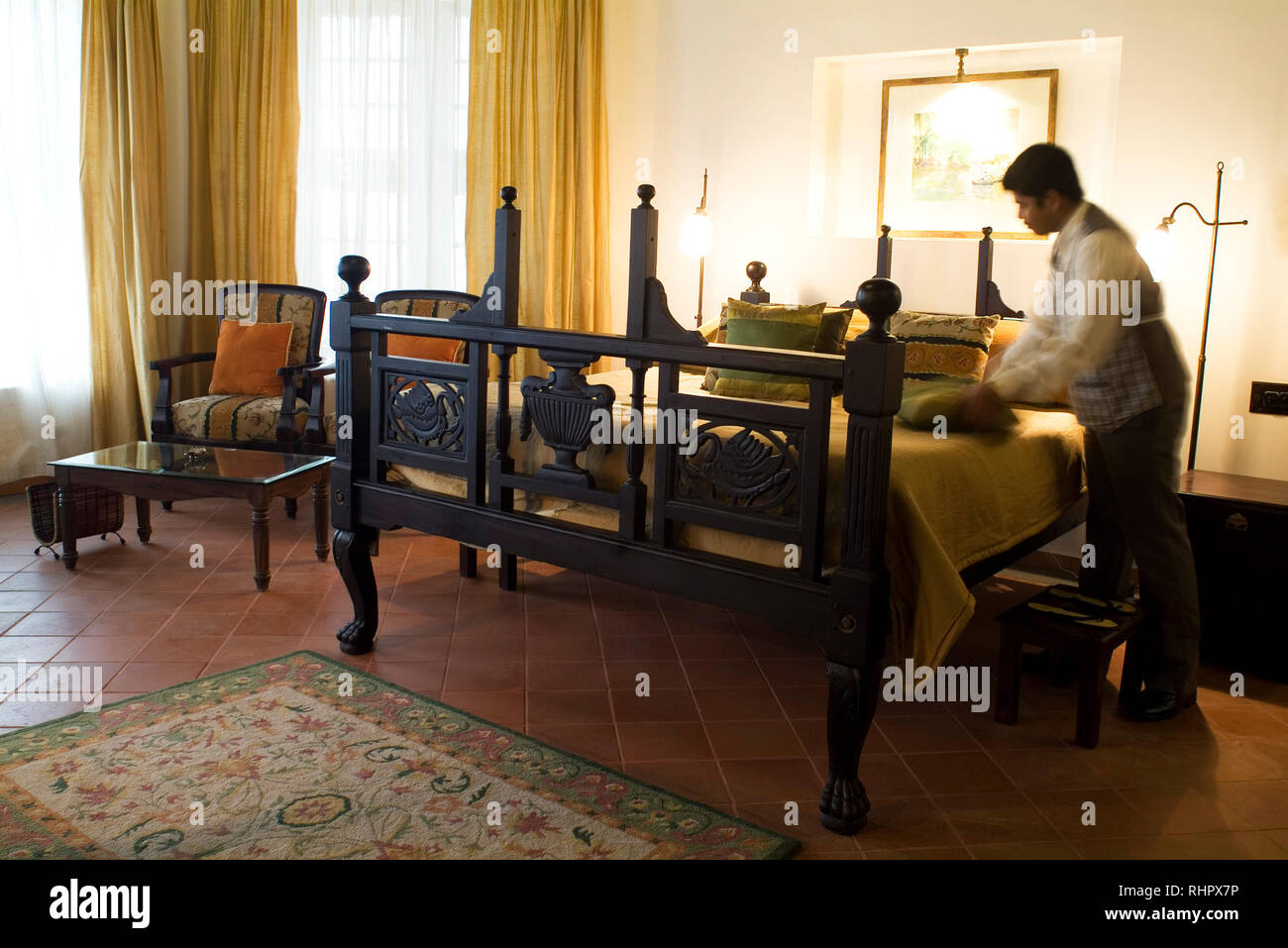 A guest room at historical Koder House, a mansion structured and gabled in Europe before shipped to Fort Cochin in India to be reassembled. The statel Stock Photo