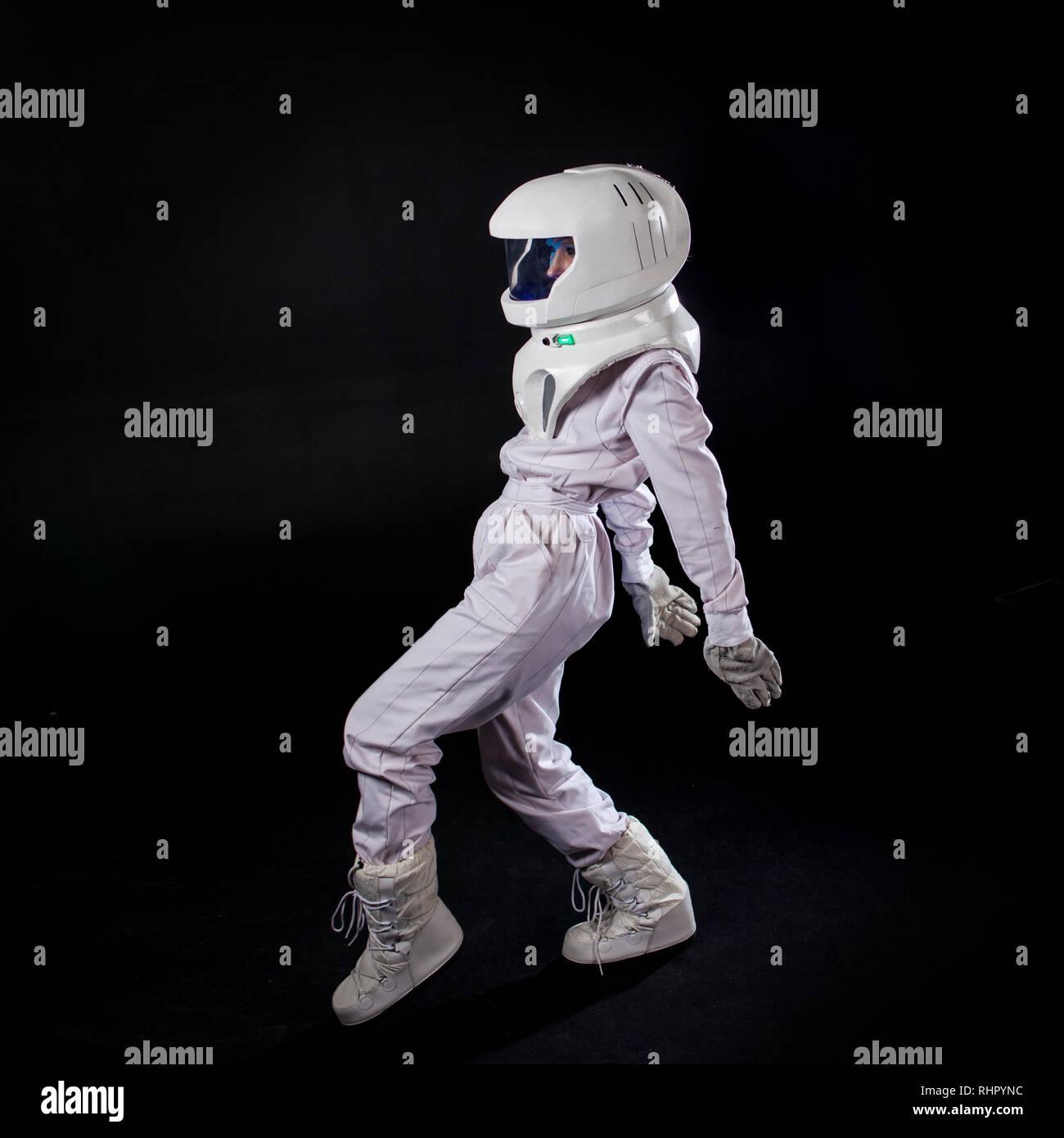 Running Astronaut in space, in zero gravity on black background
