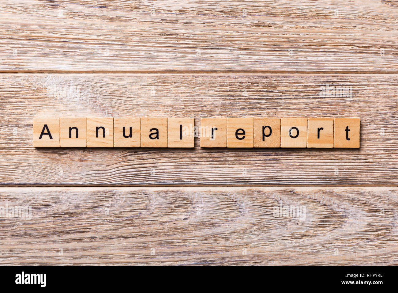 Annual report word written on wood block. Annual report text on wooden table for your desing, concept. - Stock Image