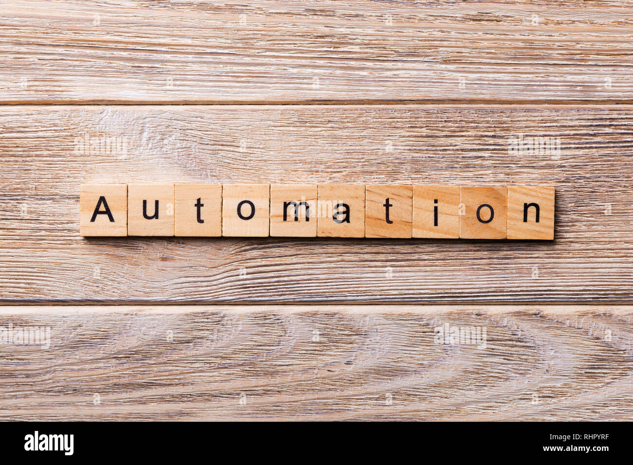 Automation word written on wood block. Automation text on wooden table for your desing, concept. - Stock Image